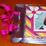 using badge holders and personalized ribbons to create a festive holiday photo album