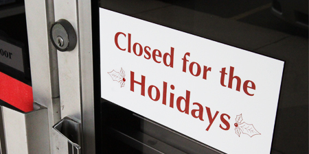 Holiday signs displayed on office door